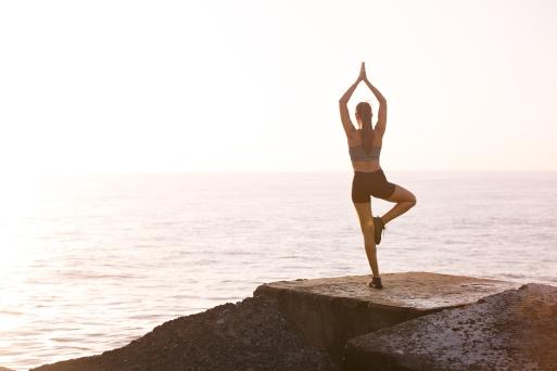 Canva - Woman Meditating On Rock Near Body Of Water.jpg